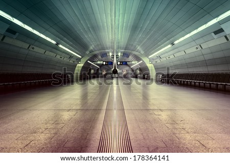 symmetric underground station hall with colored illumination - stock photo