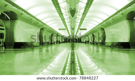 Symmetrical long corridor in metro station. Green tint - stock photo