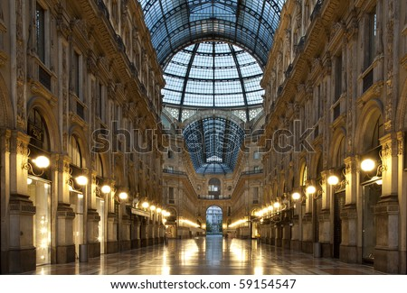 Symmetrical night shot of the famous Galleria Vittorio Emanuele II in Milan, Italy, a covered luxury shopping mall - stock photo
