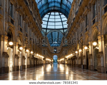 Symmetrical night shot of the hall of the landmark arcade or covered mall, Galleria Vittorio Emanuele II in Milan, Italy - stock photo