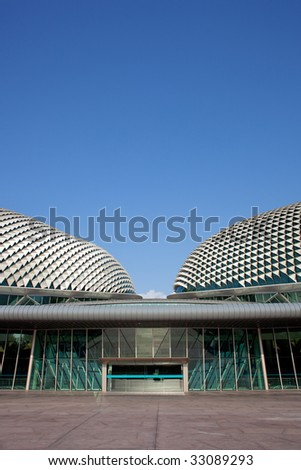 Symmetrical roofs of the Esplanade Theatre in Singapore with lots of copyspace at the top - stock photo