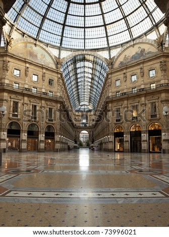 Symmetrical shot at dawn of the hall of the landmark arcade or covered mall, Galleria Vittorio Emanuele II in Milan, Italy - stock photo