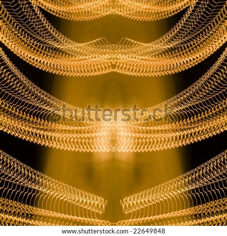 Symmetrical traces of street illumination. Shutter low speed. - stock photo