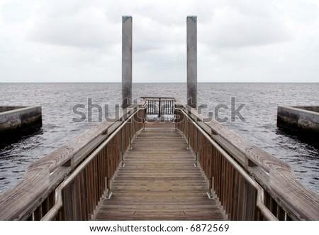 Symmetrical wooden pier. - stock photo