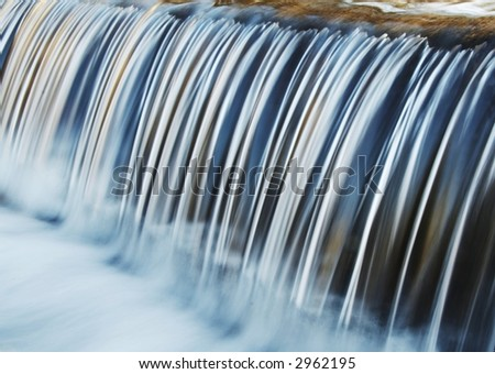Symmetry water cascade in park - stock photo