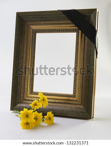 sympathy flower with gold frame - stock photo