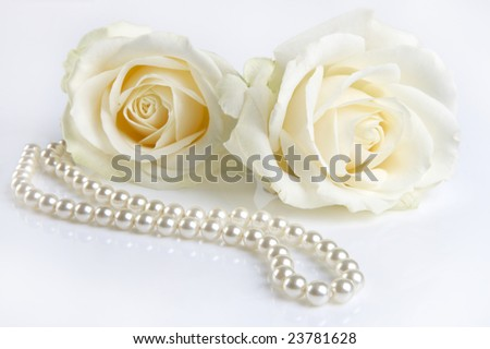 Symphony in white, two white roses and a pearl necklace, as a valentine gift - stock photo