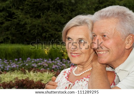 Sympothetic elderly couple went for a walk in the park