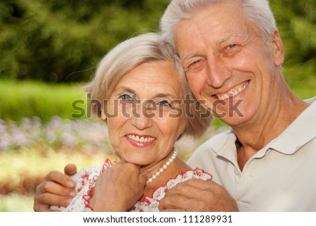 Sympothetic elderly couple went for a walk in the park - stock photo