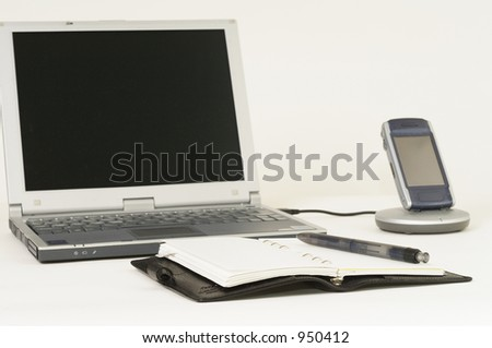 synchronize - cell phone synchronizing data with laptop - stock photo