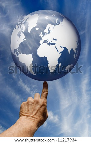 Synthetic digital blue globe poised on a single finger tip against a summer sky with cirrus clouds. - stock photo