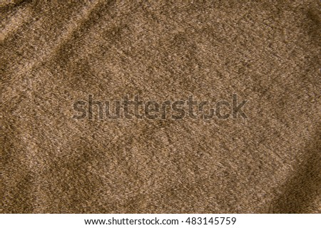 Synthetic fur brown background.