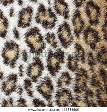 Synthetic leopard fur texture background - stock photo