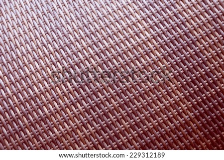 Synthetic rattan texture weaving background as used on outdoor garden furniture.