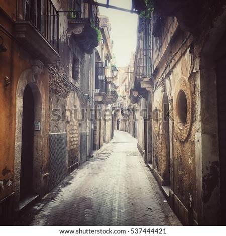 Syracuse, Italy - December 14, 2016: Narrow street on Ortygia island, old part of Syracuse city on Sicily