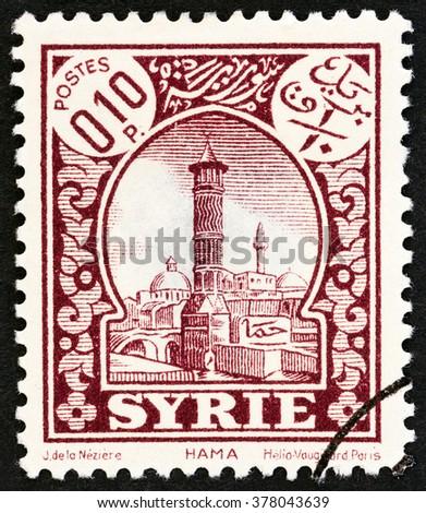 SYRIA - CIRCA 1930: A stamp printed in Syria shows Hama, circa 1930. - stock photo