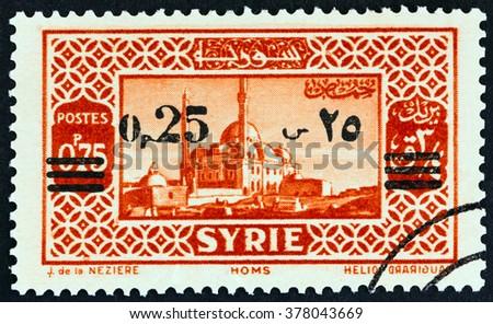 SYRIA - CIRCA 1938: A stamp printed in Syria shows Homs, circa 1938. - stock photo