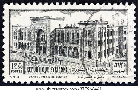 SYRIA - CIRCA 1952: A stamp printed in Syria shows Palace of Justice, Damascus, circa 1952.  - stock photo
