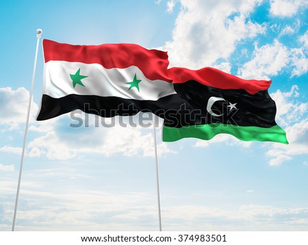 Syria & Libya Flags are waving in the sky - stock photo