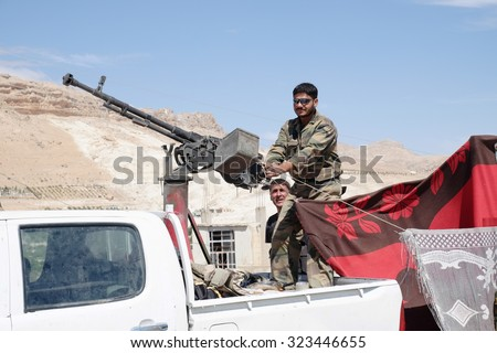 SYRIA, MAALULA - SEPTEMBER 2013. The soldiers of the Syrian National Army at the gates of the city Ma'loula. Maaloula became a place of fighting between Assad forces and the rebels. - stock photo