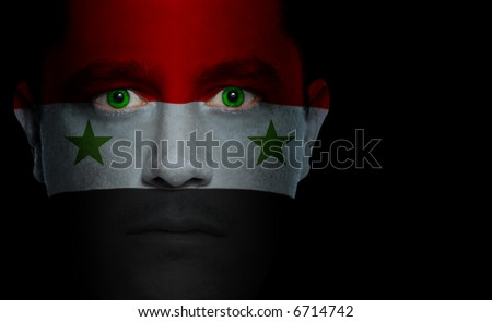 Syrian flag painted/projected onto a man's face