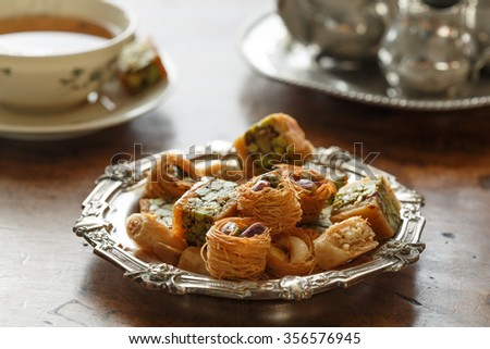 Syrian pastry with pistachios and nuts and a cup of tea - stock photo