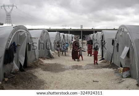 Syrian refugees families who came from Kobani district living in refugees tent in Suruc district, 16 October 2015 , Turkey , Sanliurfa. - stock photo