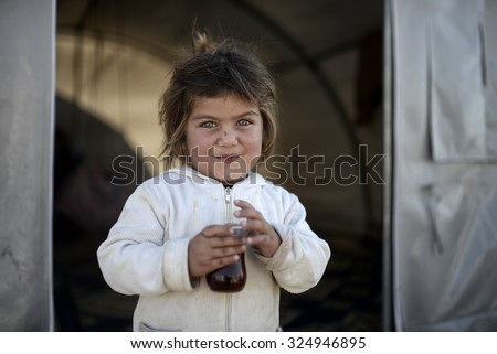 Syrian refugees families who came from Kobani district living in refugees tent in Suruc district, 25 October 2015, Turkey, Sanliurfa.  - stock photo