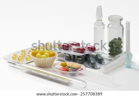 syringe, ampoule, thermometer and pills on white background - stock photo