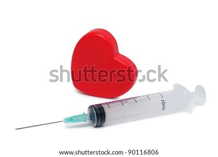 Syringe and heart isolated on white background. - stock photo