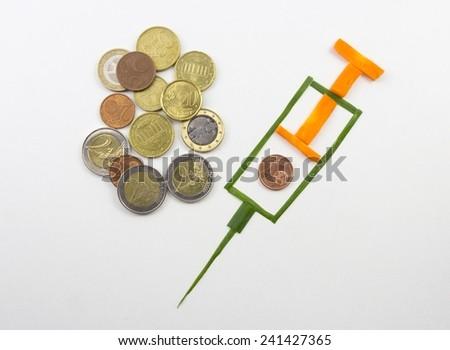 syringe and money - stock photo