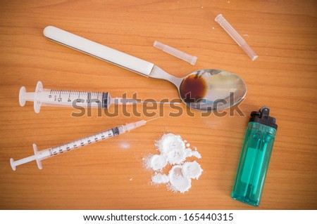 syringe and spoon and lighters - stock photo
