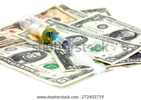 Syringe for injection, an ampule with medication and dollars