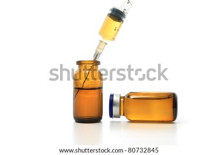Syringe, glass bottles with drugs isolated on white - stock photo