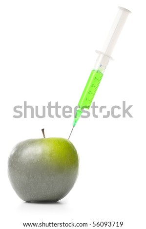 syringe in green apple isolated on white - stock photo