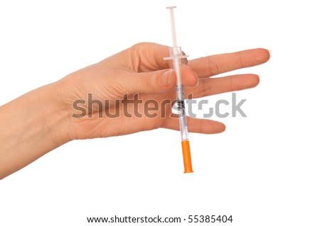 syringe in the woman's hand for making injections