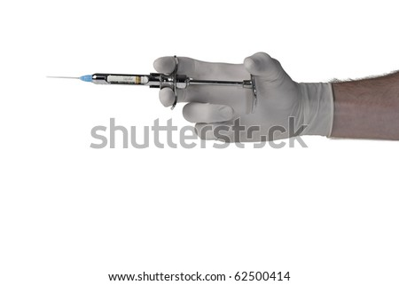 Syringe with a medicine in a hand - stock photo