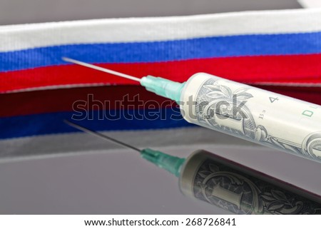 Syringe with dollars pierce the ribbon of the Russian flag - stock photo