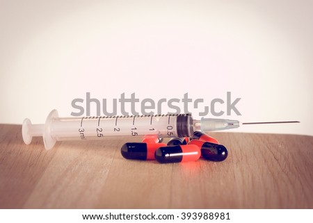 syringe with filter effect retro vintage style - stock photo