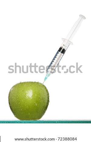 Syringes stuck in an apple - stock photo