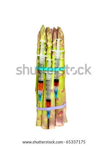 syringes with asparagus,concept of gmo technology or medicinal benefits of vegetables - stock photo