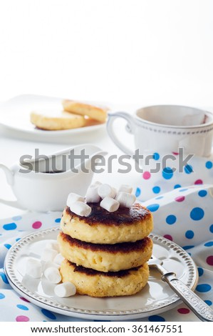 Syrniki cheese pancakes with sour cream