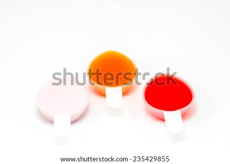 Syrup Medication in teaspoons  on White Background - stock photo