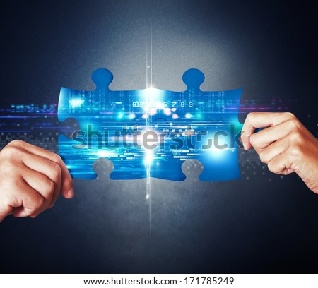 System integration concept with union of puzzle - stock photo