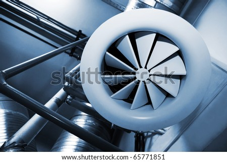 System of ventilating pipes at a modern factory - stock photo
