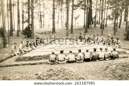 SZCZAWNICA, POLAND, CIRCA 1950's: Vintage photo of group of scouts in forest - stock photo