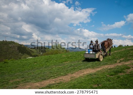 Szczawnica, Poland - May 9, 2015: Men transport fresh sheep milk to smokehouse located in remote hill in Pieniny and Tatras mountain range in lesser Poland.
