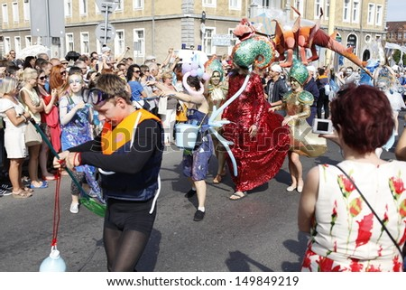 SZCZECIN, POLAND - AUGUST 4th: Crew Parade during the Final of The Tall Ships Races 2013 in Szczecin, the crews of the tall ships with street artists paraded through the streets of Szczecin, Poland.