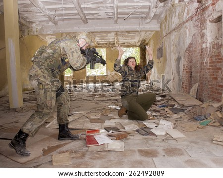 SZCZECIN, POLAND - MAY 31, 2014: Female hostage and soldier with gun, during historical reconstruction