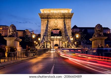 Szechenyi Chain Bridge (Hungarian: Szechenyi lanchid) by night in the city of Budapest, Hungary. - stock photo